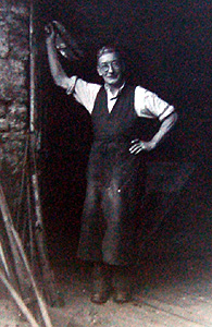 Leonard Herbert at the smithy from the Biddenham Women's Institute scrapbook [X535/6]