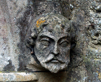 Head on the west side of the chancel north door October 2009