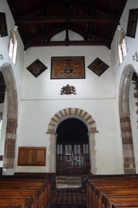 The church interior looking west showing the Norman arch - August 2009
