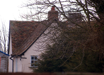 A glimpse of Bridge Farmhouse from the road March 2010
