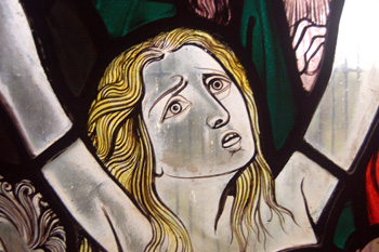 Detail from the group of damned on the west window November 2009