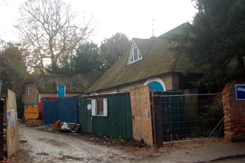 Listed outbuildings at Clifton House November 2009 surrounded by builders' detritus