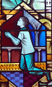 Worshipping boy on the north aisle window July 2012