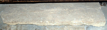 a medieval grave slab in Harrold church porch May 2008