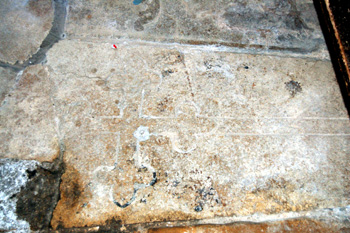 Medieval gravestone in Harrold church porch May 2008