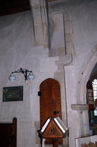 The door and doorway to the rood screen on the south side of the chancel January 2011