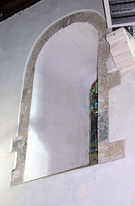 Norman window in the north wall of the nave September 2011