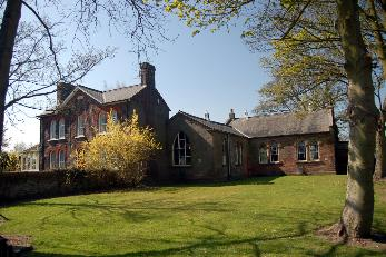 The former school house and old school buildings April 2007