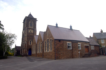 Saint Barnabas church and former National School June 2008