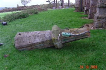 Damaged spire in the churchyard - copyright All Saints Little Staughton