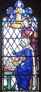 The Holy Family detail from the north aisle window February 2010