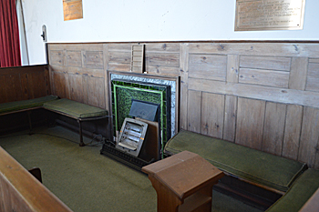 Box pew and fireplace on the south side of the chancel October 2015