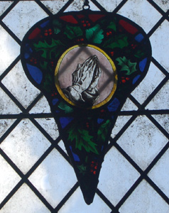 Fragment of stained glass in the north aisle May 2010