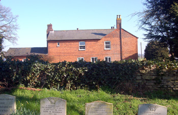 College Farmhouse seen from the churchyard March 2011