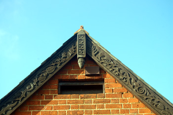 Decorative bargeboard at the gable of the small property January 2011