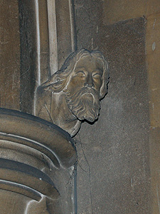 Head on the south side of the chancel arch June 2011