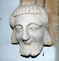male head in Stagsden church porch December 2007