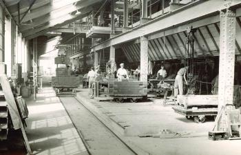 Press shed with men stacking green bricks [Z41/LB10/1/2/32]