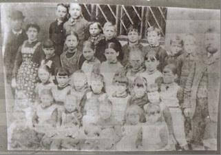 Group photograph taken c.1890, pupils and teachers outside the schoolroom window [Z49/765]