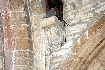 Head corbel on the north wall of the chancel May 2011